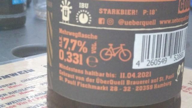 Etikett einer Bierflasche mit Fahrradsymbol.
